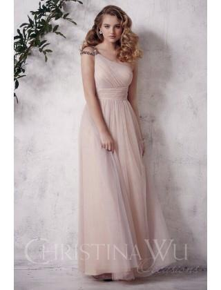 [Image: Pick a long nude bridesmaid dress for your neutral wedding. This dress fits every style perfectly. ]