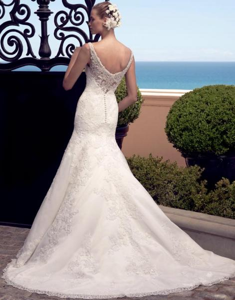 [Image: We love this low back wedding gown with lace detail! This gown fits tightly with a long train. ]
