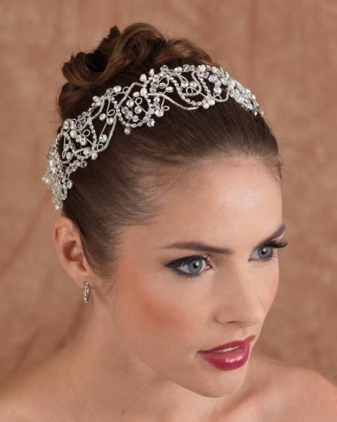 A jewel headband is a trendy style for many brides. Jeweled headbands are perfect for any style of wedding. Add a hairpiece to your look.