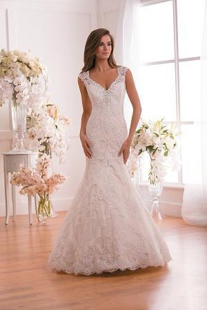 [Image: A v-neck lace wedding gown in white is classic, yet stunning. ]